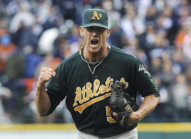 Oakland Athletics relief pitcher Grant Balfour clenches his fist after the final out Game 3 of an American League baseball division series against the Detroit Tigers in Detroit, Monday, Oct. 7, 2013. Oakland won 6-3. (AP Photo/Lon Horwedel)