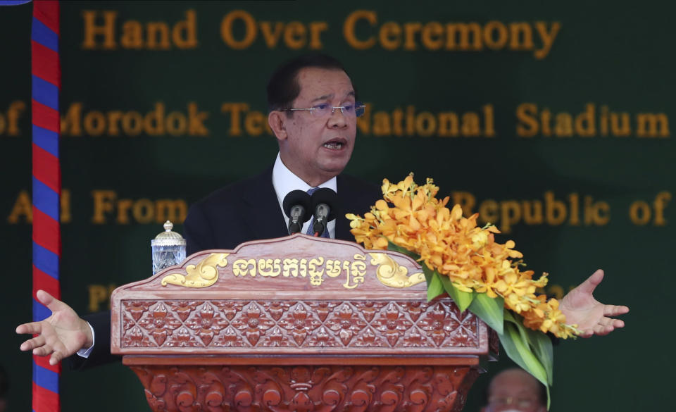 Cambodian Prime Minister Hun Sen delivers a speech during a ceremony to hand over the Morodok Techo National Stadium, as it was handed over to the Cambodian organizing committee of the Southeast Asian Games, in Phnom Penh, Cambodia, Sunday, Sept. 12, 2021. China's Foreign Minister Wang Yi is visiting Cambodia, where he met with Hun Sen and other officials to discuss COVID-19 and other regional issues. (Lon Jadina/Pool Photo via AP)