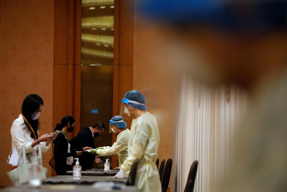 Attendees taking an antigen rapid test before a conference held by the Institute of Policy Studies at Marina Bay Sands Convention Centre in Singapore.