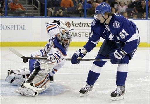Edmonton Oilers goalie Nikolai Khabibulin (35), of Russia, stops a shot by Tampa Bay Lightning center Steven Stamkos (91) during the second period of an NHL hockey game Thursday March 22, 2012, in Tampa, Fla. (AP Photo/Chris O'Meara)