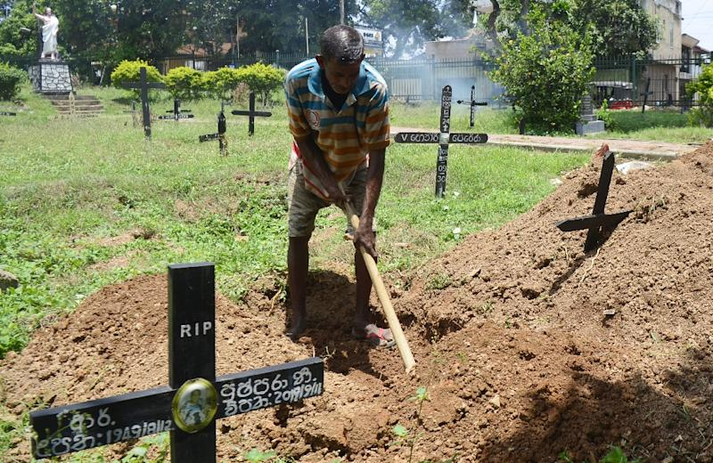 Piyasri Gunasena digs a grave at Madampitiya cemetery in Sri Lanka's capital Colombo -- he usually only digs one a day but since the Easter Sunday attacks, he is far busier (AFP Photo/LAKRUWAN WANNIARACHCHI)
