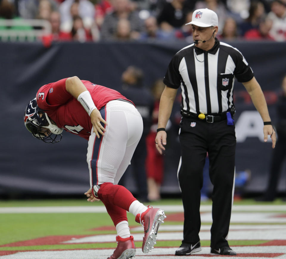 HOUSTON, TX - DECEMBER 10: Referee John Hussey #35 watches Tom Savage #3 of the Houston Texans get off the turf after a hit in the second quarter against the San Francisco 49ers at NRG Stadium on December 10, 2017 in Houston, Texas. (Photo by Tim Warner/Getty Images)