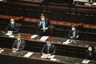 Premier Giuseppe Conte, top center, delivers his speech at the lower chamber of Parliament, in Rome, Monday, Jan. 18, 2021. Conte fights for his political life with an address aimed at shoring up support for his government, which has come under fire from former Premier Matteo Renzi's tiny but key Italia Viva (Italy Alive) party over plans to relaunch the pandemic-ravaged economy. (AP Photo/Alessandra Tarantino, pool)