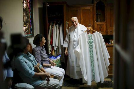Father Bartholomew Daly hangs his garment after giving the last mass at the Church of Our Lady Peace in New York July 31, 2015. REUTERS/Eduardo Munoz