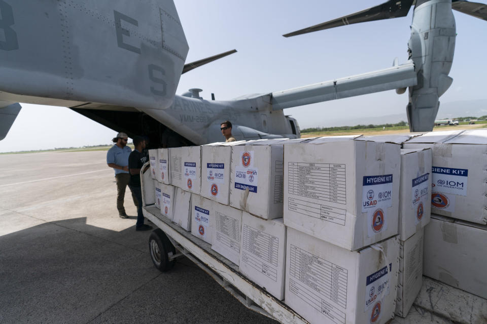 """Hygiene Kits are loaded onto a VM-22 Osprey at Toussaint Louverture International Airport, Saturday, Aug. 28, 2021, in Port-au-Prince, Haiti. The VMM-266, """"Fighting Griffins,"""" from Marine Corps Air Station New River, from Jacksonville, N.C., are flying in support of Joint Task Force Haiti after a 7.2 magnitude earthquake on Aug. 22, caused heavy damage to the country. (AP Photo/Alex Brandon)"""