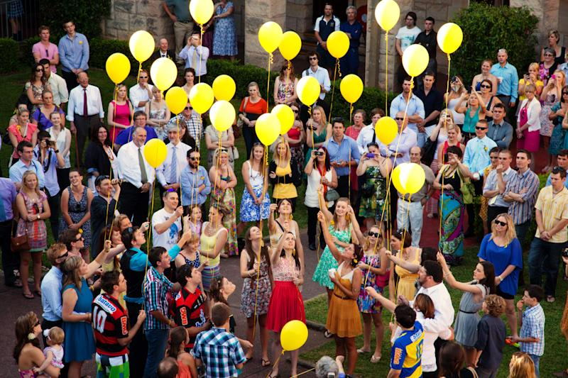 Twenty-three yellow balloons released at Sarah Frazer's wake attended by hundreds of people in NSW.