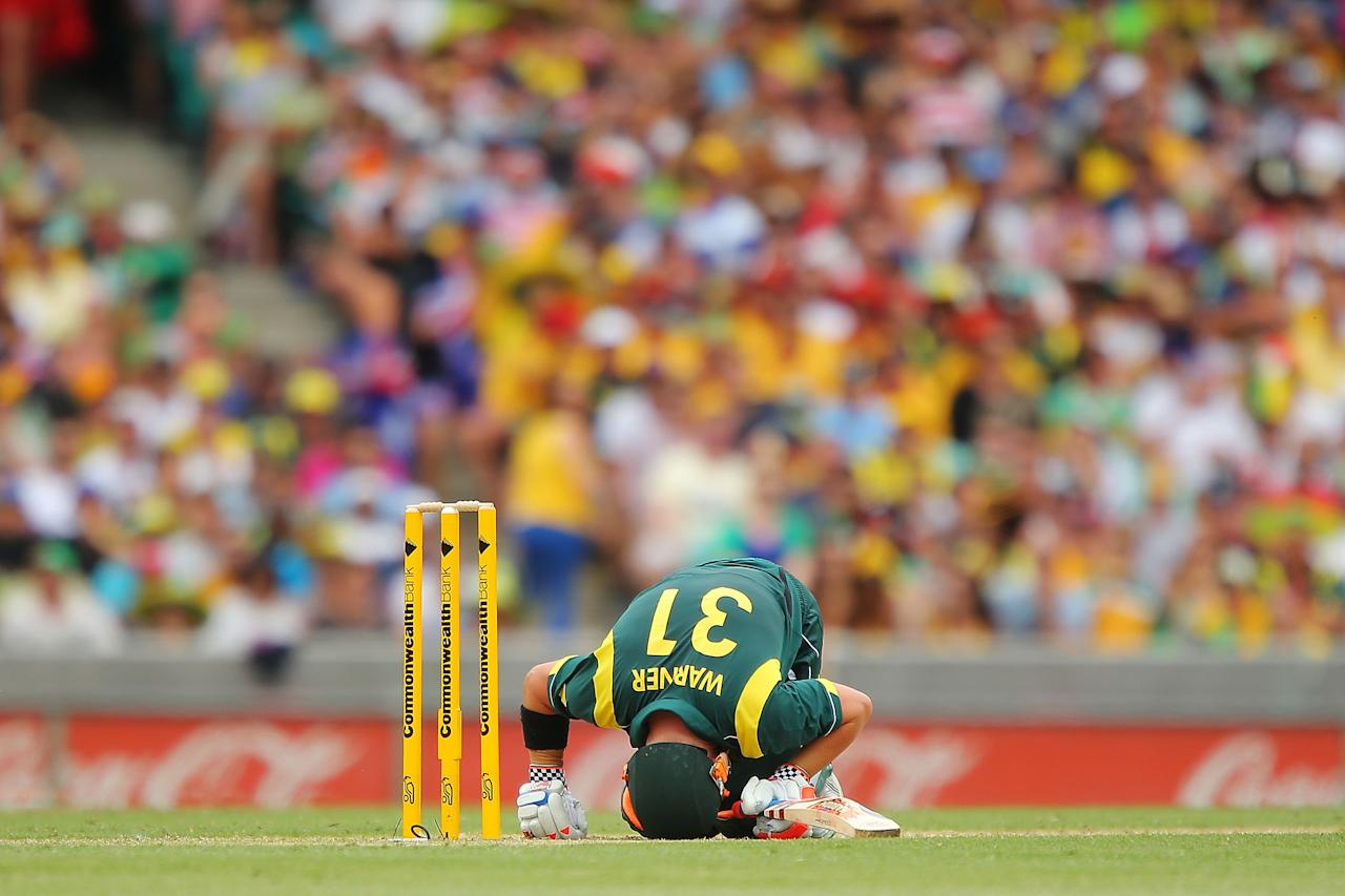 SYDNEY, AUSTRALIA - JANUARY 20:  David Warner of Australia slumps to the ground after being hit by a Nuwan Kulasekara of Sri Lanka delivery during game four of the Commonwealth Bank one day international series between Australia and Sri Lanka at Sydney Cricket Ground on January 20, 2013 in Sydney, Australia.  (Photo by Brendon Thorne/Getty Images)