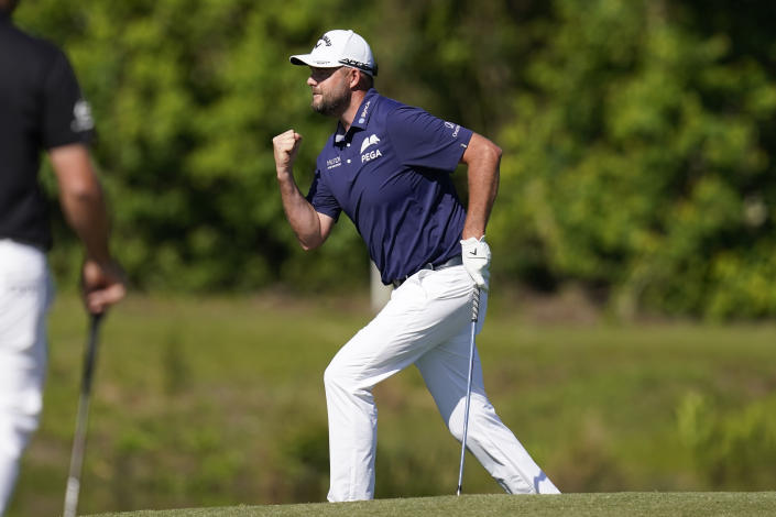 Marc Leishman, of Australia, reacts after making a putt on the 16th green during the final round of the PGA Zurich Classic golf tournament at TPC Louisiana in Avondale, La., Sunday, April 25, 2021. (AP Photo/Gerald Herbert)