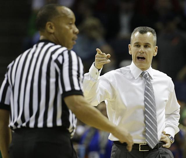 Florida head coach Billy Donovan, speaks to an official during the first half in a regional semifinal game against UCLA at the NCAA college basketball tournament, Thursday, March 27, 2014, in Memphis, Tenn. (AP Photo/Mark Humphrey)