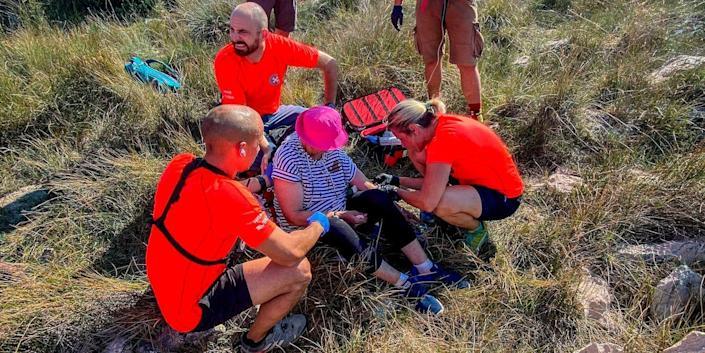 This photo provided by the Croatian Mountain Rescue Service, shows the rescue operation of an unidentified woman who was found on the Adriatic island of Krk on Sept. 12, 2021.