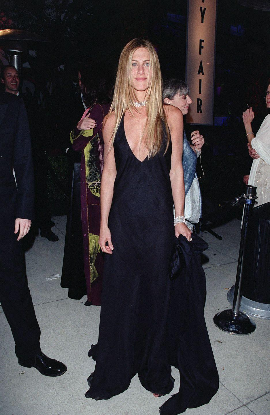 <p>Jennifer showed off this plunging neckline to the Vanity Fair Oscars Party in 2000. It's a timeless, classic look.</p>