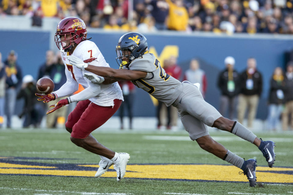 Iowa State wide receiver La'Michael Pettway (7) catches the ball as West Virginia cornerback Tae Mayo (20) attempts to knock it away during the second half of an NCAA college football game Saturday, Oct. 12, 2019, in Morgantown, W.Va. (AP Photo/Raymond Thompson)