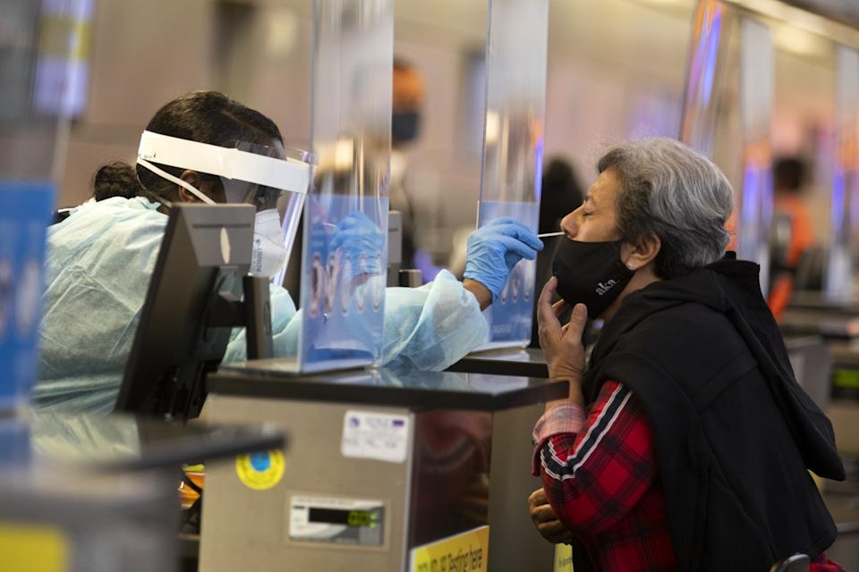 Ana Ramos is tested for the coronavirus in the Tom Bradley Terminal at Los Angeles International Airport.