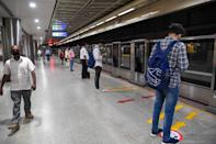 Commuters wait for a Yellow Line train in a station after Delhi Metro Rail Corporation (DMRC) resumed services in New Delhi on September 7, 2020.(Photo by PRAKASH SINGH/AFP via Getty Images)