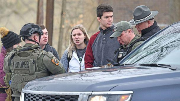 PHOTO: Students from Ohio State University Mansfield answer questions from law enforcement Monday afternoon, Feb. 11, 2019, after a student was abducted on campus. (Jason J. Molyet/News Journal via USA Today Network)