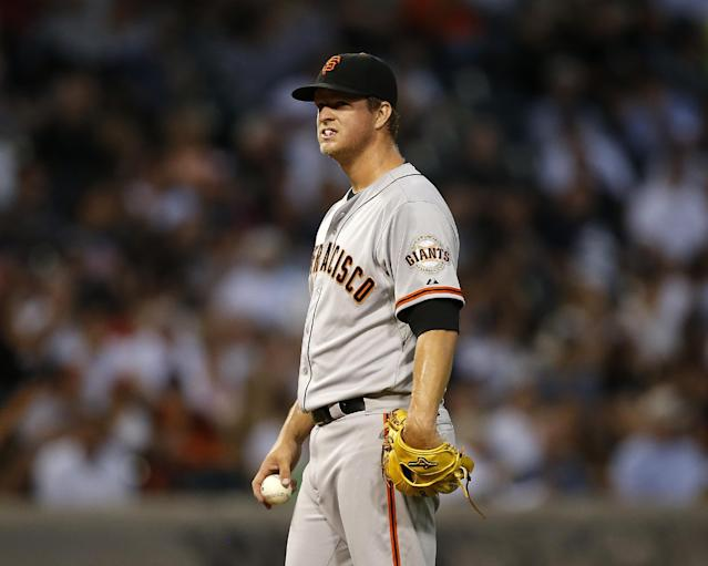 San Francisco Giants starting pitcher Matt Cain reacts after giving up 3 runs during the fourth inning of a baseball game against the Chicago White Sox on Tuesday, June 17, 2014, in Chicago. (AP Photo/Andrew A. Nelles)