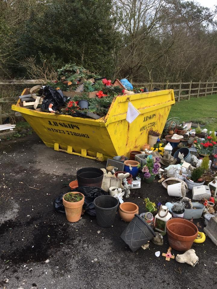 Treasures left at gravesides were thrown into a skip by council workers clearing Parkside Cemetary, Bucks (Ann Sibley/Facebook)