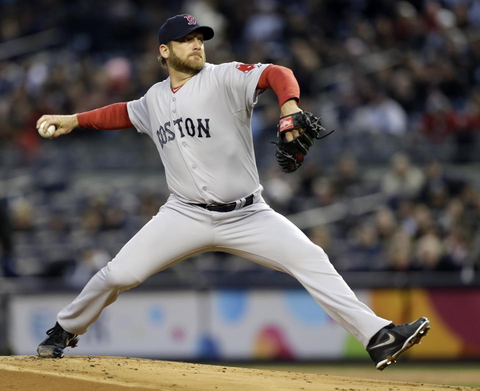 Boston Red Sox starting pitcher Ryan Dempster winds up in the first inning of a baseball game against the New York Yankees at Yankee Stadium in New York, Thursday, April 4, 2013. (AP Photo/Kathy Willens)