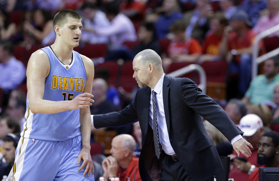Denver Nuggets star Nikola Jokic and coach Mike Malone have a complicated relationship. (AP)