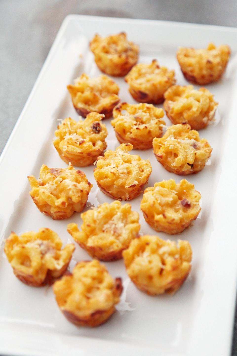 """<p>You know your dinner is off to a good start when mac and cheese makes a debut at the top of the menu! These little bites are filled with warm noodles and rich cheese, making it hard to stop eating them. Dig in!</p> <p><strong>Get the recipe:</strong> <a href=""""https://www.popsugar.com/food/Mini-Macaroni-Cheese-Appetizer-Recipe-5876505"""" class=""""link rapid-noclick-resp"""" rel=""""nofollow noopener"""" target=""""_blank"""" data-ylk=""""slk:three-cheese mini macaroni and cheese bites"""">three-cheese mini macaroni and cheese bites</a></p>"""