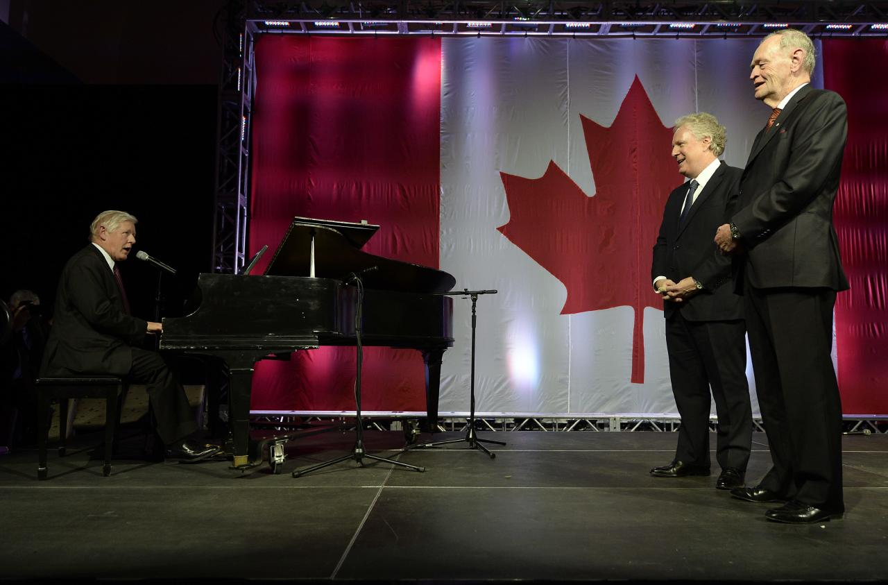 Bob Rae sings happy birthday to Jean Chretien as Jean Charest looks on at the 50 Years of Standing Up for Canada event in Toronto