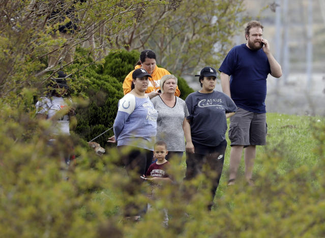 <p>Residents of the apartment complex where Waffle House shooting suspect Travis Reinking lived watch as police work near the wooded area where Reinking was captured Monday, April 23, 2018, in Nashville, Tenn. Police say Reinking shot and killed at least four people at a nearby Waffle House restaurant Sunday. (Photo: Mark Humphrey/AP) </p>