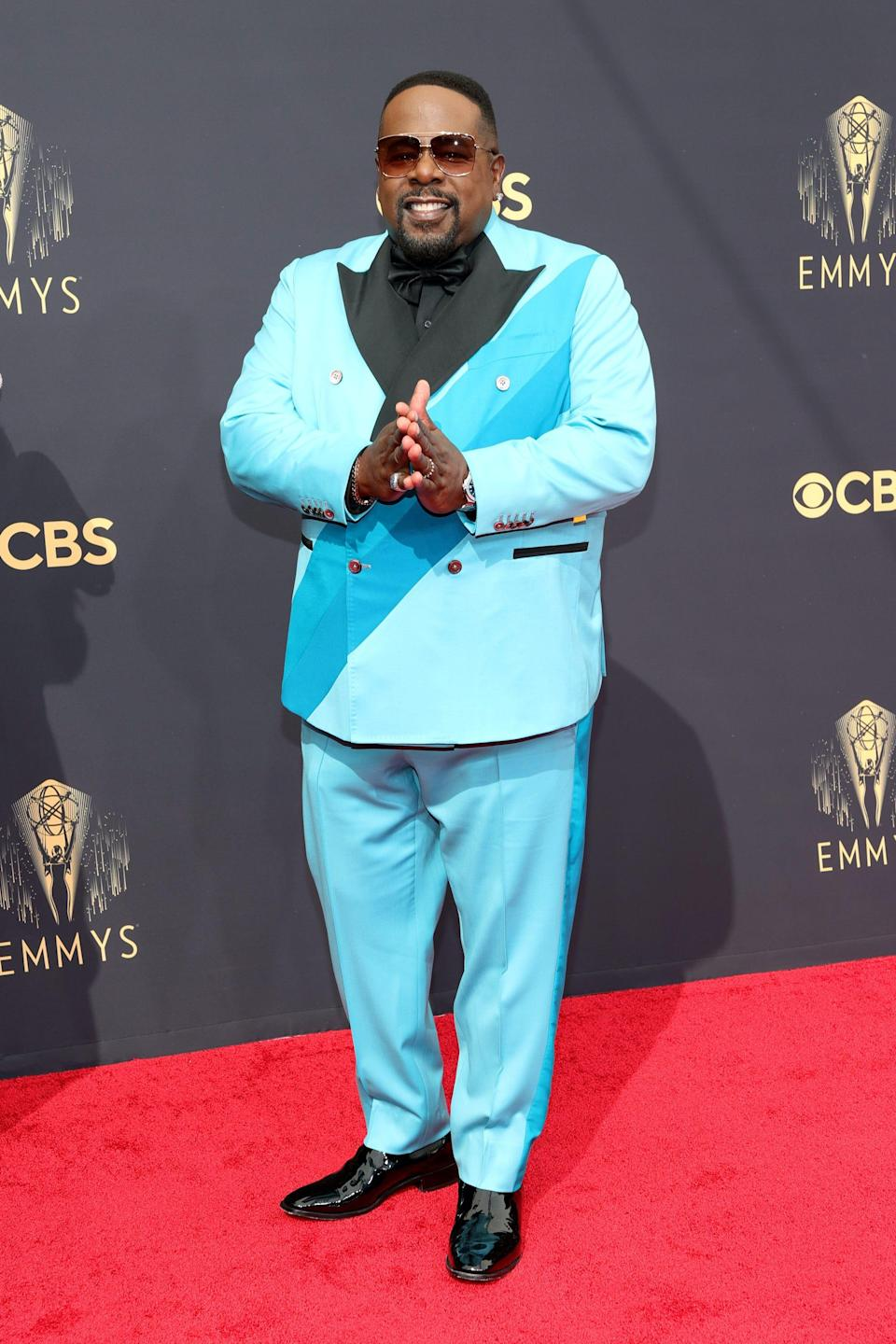 Cedric The Entertainer wears a blue suit on the Emmys red carpet.