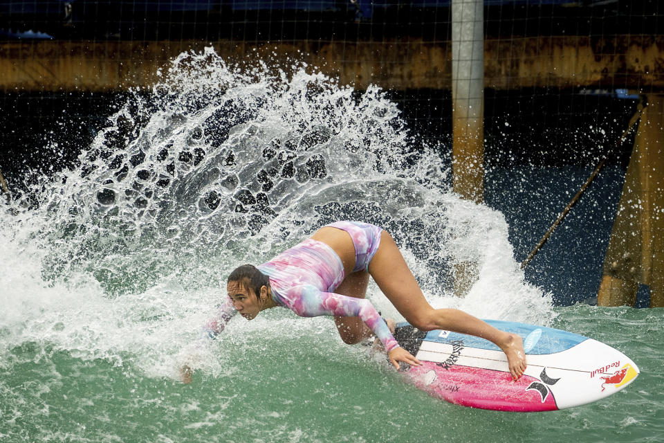 Carissa Moore of the United States, practices for a World Surf League competition at Surf Ranch on Wednesday, June 16, 2021, in Lemoore, Calif. The Summer Games in Tokyo, which kick off this month, serve as a proxy for that unresolved tension and resentment, according to the Native Hawaiians who lament that surfing and their identity have been culturally appropriated by white outsiders who now stand to benefit the most from the $10 billion industry. (AP Photo/Noah Berger)