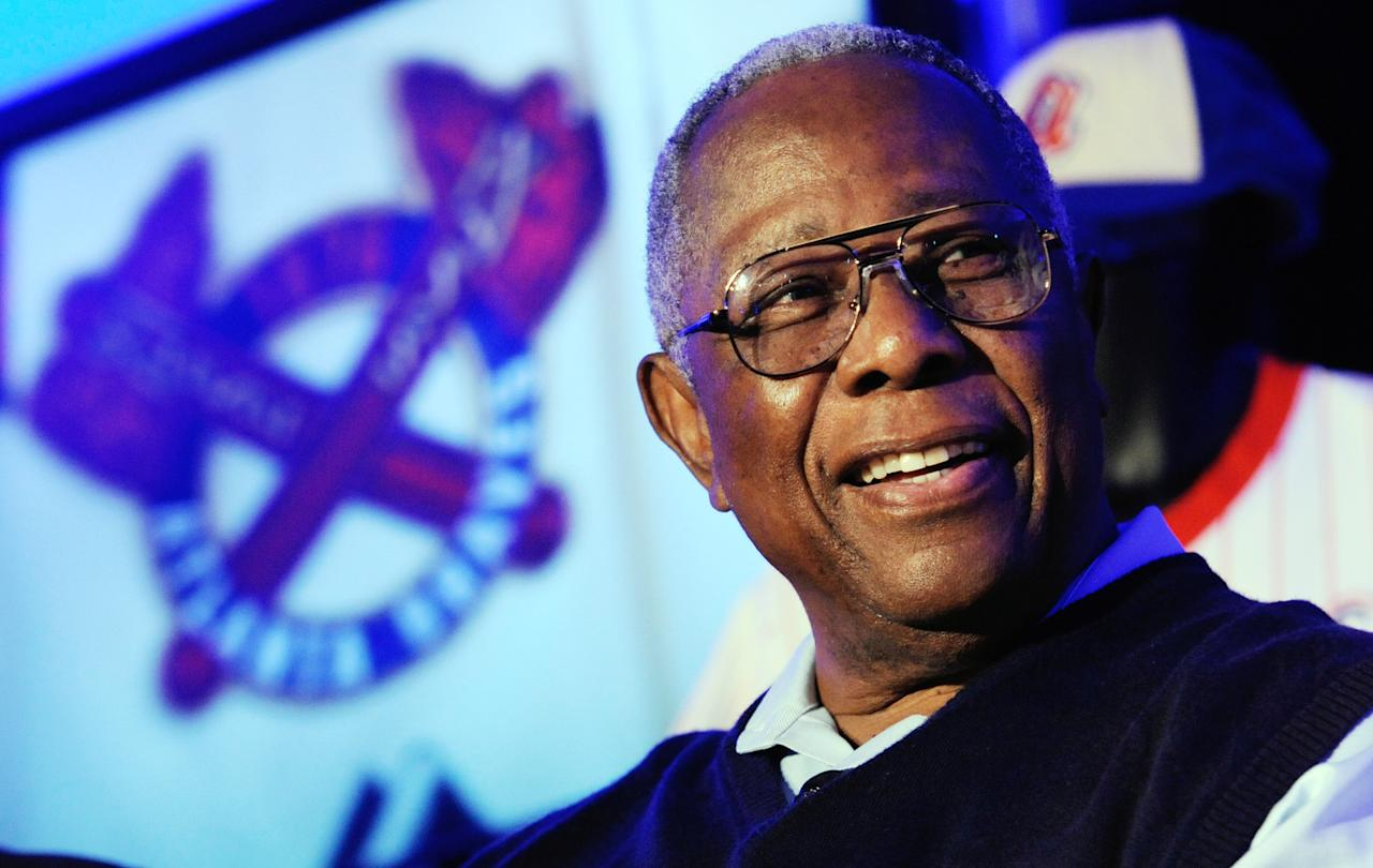 Atlanta Braves' Hank Aaron attends a news conference to unveil the club's new alternative home uniform, Monday, Feb. 6, 2012, in Atlanta. The new uniform will feature a patch bearing the image at left, and pays homage to the team's past, reflecting more of the look of the 1966 team when Aaron played. (AP Photo/John Amis)