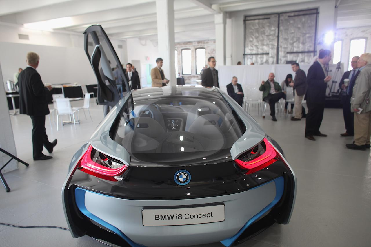 NEW YORK, NY - NOVEMBER 09:  The back of the BMW i8 concept vehicle is displayed at a sneak preview of the car along with the BMW i3 on November 9, 2011 in New York City. The fully electric BMW i3 and the hybrid BMW i8 are the first electric and hybrid-electric vehicles to use primarily carbon fiber that is a strong and lightweight material that that could significantly reduce fuel consumption and emissions. Both vehicles will make their official North American debuts at the Los Angeles Auto Show on November 16 and 17.  (Photo by Spencer Platt/Getty Images)