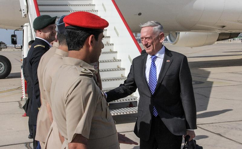 US Secretary for Defense Jim Mattis shakes hands with Omani officials upon his arrival in the capital Muscat on March 11, 2018