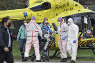 A COVID-19 patient from the Netherlands arrives for treatment by helicopter to the University hospital in Muenster, Germany, Friday, Oct. 23, 2020. The transfer is intended to reduce the coronavirus pressure on the intensive care units in the Netherlands. (AP Photo/Martin Meissner)