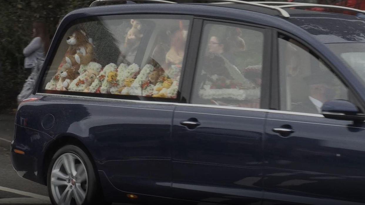A hearse passes during the funeral procession for Azaylia Cain (PA Video)