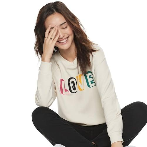 """<p>""""POPSUGAR is all about positivity and joy and what better way to express that upbeat sentiment than with this <a href=""""https://www.popsugar.com/buy/Popsugar-Relaxed-Sweatshirt-505208?p_name=Popsugar%20Relaxed%20Sweatshirt&retailer=kohls.com&pid=505208&price=40&evar1=fab%3Aus&evar9=46805008&evar98=https%3A%2F%2Fwww.popsugar.com%2Ffashion%2Fphoto-gallery%2F46805008%2Fimage%2F46805009%2FPopsugar-Relaxed-Sweatshirt&prop13=api&pdata=1"""" rel=""""nofollow"""" data-shoppable-link=""""1"""" target=""""_blank"""" class=""""ga-track"""" data-ga-category=""""Related"""" data-ga-label=""""https://www.kohls.com/product/prd-3909303/womens-popsugar-relaxed-sweatshirt.jsp?prdPV=3"""" data-ga-action=""""In-Line Links"""">Popsugar Relaxed Sweatshirt</a> ($40) with colorful L-O-V-E lettering. On the weekends with my family, I'll pair mine back to skinny jeans and sneakers. At the office, I'll swap in moto boots and layer a blazer over top.""""</p>"""