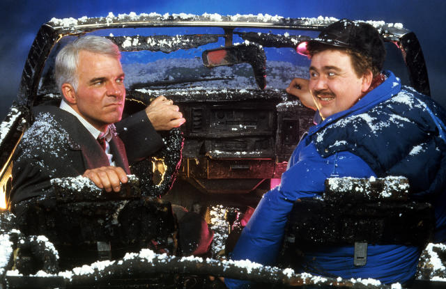 Steve Martin and John Candy sit in a destroyed car in a scene from the film 'Planes, Trains & Automobiles', 1987. (Photo by Paramount/Getty Images)
