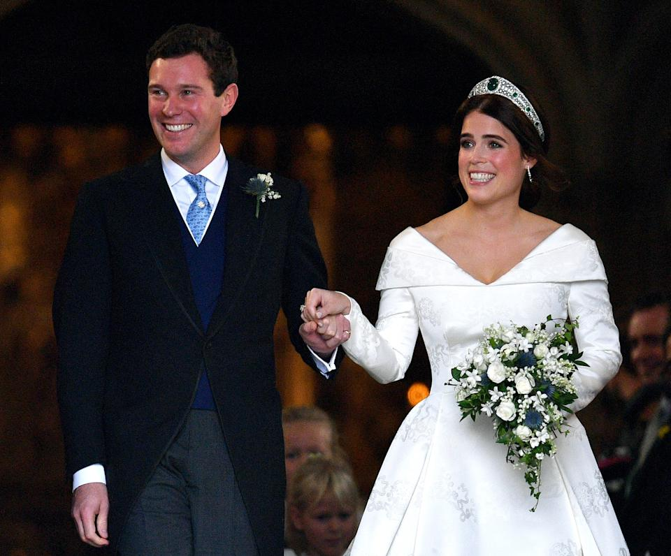 <p>Jack Brooksbank and Princess Eugenie at St George's Chapel after their wedding ceremony in October 2018. (Max Mumby/Getty Images)</p>