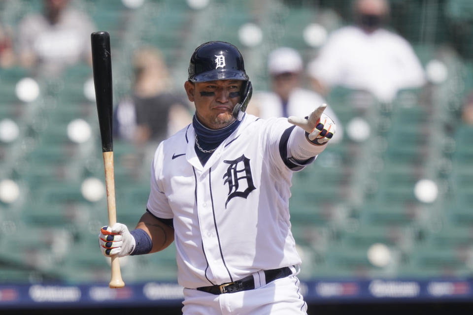 Detroit Tigers' Miguel Cabrera points to the first base umpire for a check swing during the third inning of a baseball game against the Minnesota Twins, Tuesday, April 6, 2021, in Detroit. (AP Photo/Carlos Osorio)