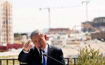 FILE PHOTO: Israeli Prime Minister Benjamin Netanyahu delivers a statement in front of new construction, in the Jewish settlement known to Israelis as Har Homa and to Palestinians as Jabal Abu Ghneim, in an area of the West Bank that Israel captured in a 1967 war and annexed to the city of Jerusalem, March 16, 2015. REUTERS/Ronen Zvulun/File Photo
