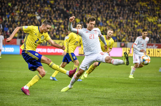 Sweden's Mikael Lustig, left, and Spain's Mikel Oyarzabal in action during their Euro 2020 Group F qualification soccer match between Sweden and Spain at Friends Arena in Solna, Stockholm, Sweden, on Tuesday Oct. 15, 2019.(Anders Wiklund / TT via AP)