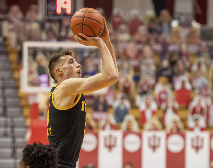 Iowa guard Joe Wieskamp (10) shoots a three-point basket during a NCAA college basketball game against Indiana, Sunday, Feb. 7, 2021, in Bloomington, Ind. Indiana. (AP Photo/Doug McSchooler)