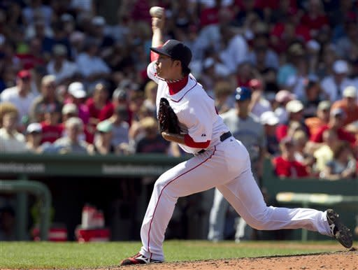 Boston Red Sox's Junichi Tazawa delivers a pitch against the Toronto Blue Jays in the sixth inning of a baseball game at Fenway Park in Boston, Sunday, July 22, 2012. (AP Photo/Steven Senne)