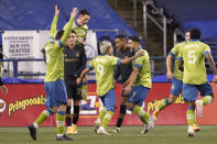 Seattle Sounders players celebrate forward Raul Ruidiaz's goal against Los Angeles FC during the second half of an MLS playoff soccer match Tuesday, Nov. 24, 2020, in Seattle. (AP Photo/Ted S. Warren)