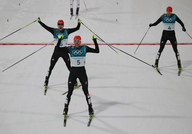 Nordic Combined Events - Pyeongchang 2018 Winter Olympics - Men's Individual 10 km Final - Alpensia Cross-Country Skiing Centre - Pyeongchang, South Korea - February 20, 2018 - Gold medalist, Johannes Rydzek of Germany, silver medalist, Fabian Riessle of Germany and bronze medalist Eric Frenzel of Germany react as they cross the finish line. REUTERS/Carlos Barria