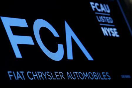 A screen displays the ticker information for Fiat Chrysler Automobiles NV at the post where it's traded on the floor of the New York Stock Exchange (NYSE) in New York City, U.S., January 12, 2016.  REUTERS/Brendan McDermid