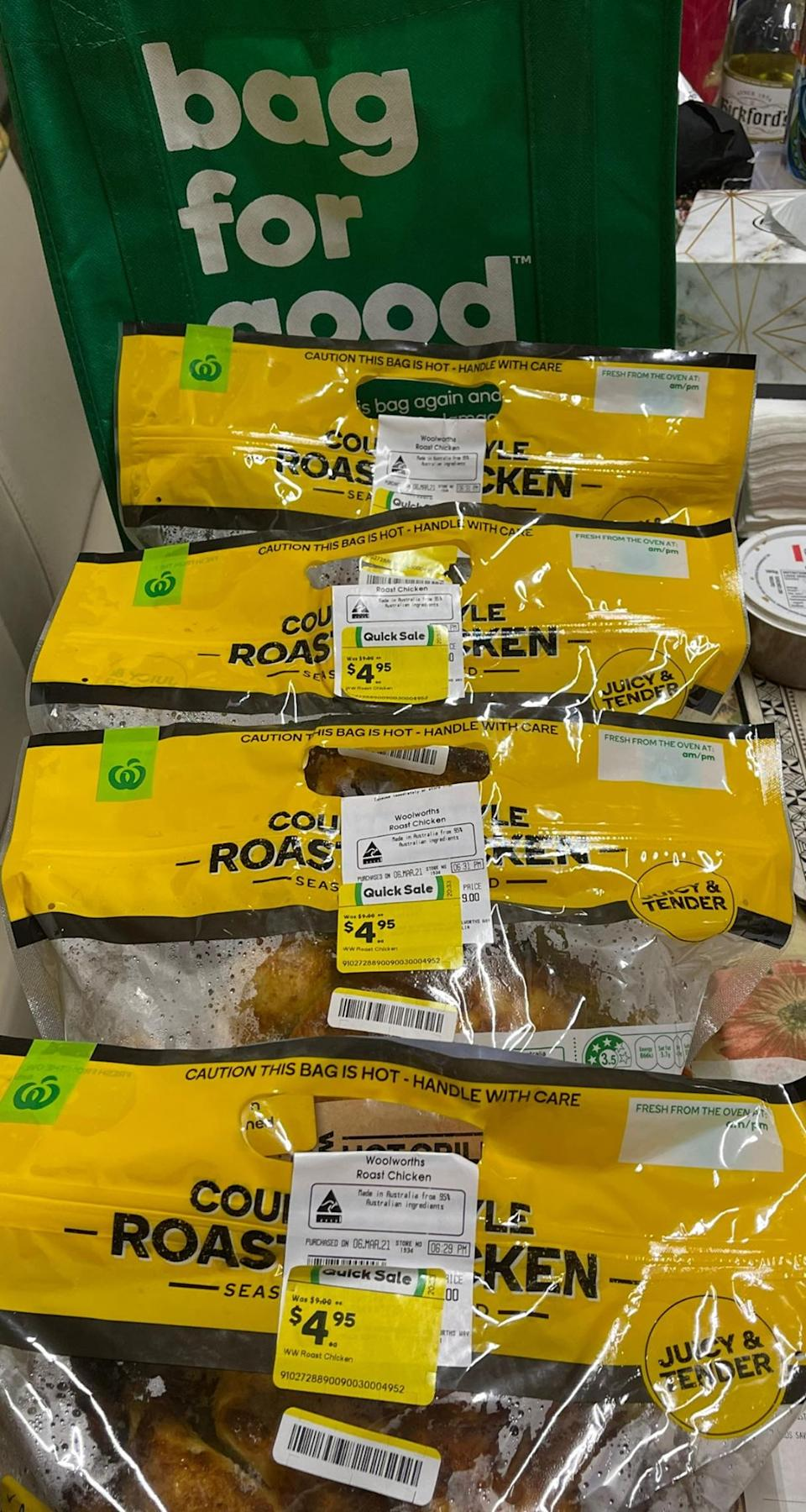Several packaged hot roast barbecue chickens from Woolworths.