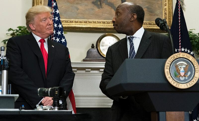 Merck CEO Kenneth Frazier is seen here with President Donald Trump at a White House event in July. (AFP Photo/SAUL LOEB)