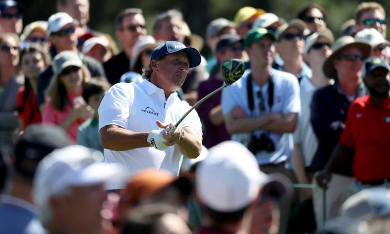 Swinging back and forth: Phil Mickelson plays a shot from the 8th during a wildly inconsistent performance at Augusta National yesterday.