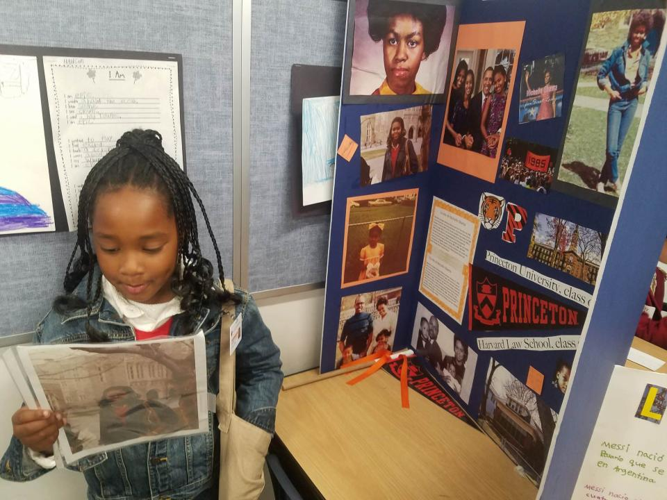 Ella-Lorraine with her exhibit on Michelle Obama at her school's Cultural Heroes Day. (Photo: The Brown family)