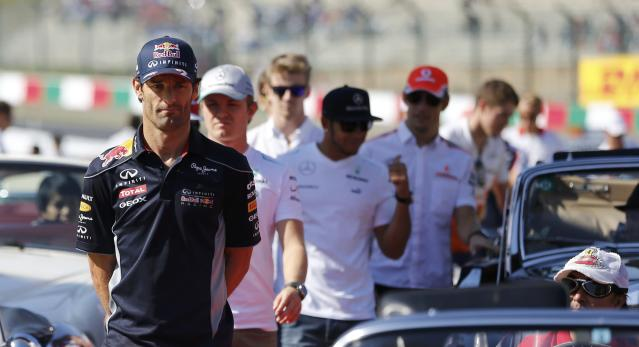 Red Bull Formula One driver Mark Webber of Australia attends the drivers' parade before the Japanese F1 Grand Prix at the Suzuka circuit October 13, 2013. REUTERS/Issei Kato (JAPAN - Tags: SPORT MOTORSPORT F1)