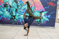 Break dancer Fabiano Lopes, 33, of Paraná, Brazil, performs in New York on Tuesday, June 22, 2021. Lopes, who dances as B-Boy Neguin, has won several international break dance competitions. He hopes to compete or coach other dancers in Paris in 2024 when breaking debuts as an official Olympic sport. (AP Photo/Ted Shaffrey)